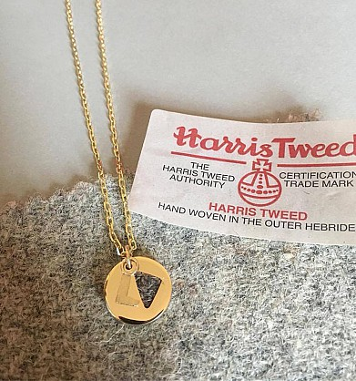 9ct yellow gold with Harris Tweed.Pendant approx 15mm with an 18inch chain