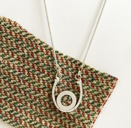 Sterling silver with Harris Tweed. Chain 18inch. Pendant approx 30x25mm